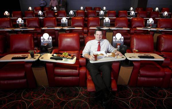 MARINA DEL REY-CA-NOVEMBER 28, 2012: AMC Spokesperson Ryan Noonan sits in the new AMC theater that allows patrons to order food and drink from their seats in Marina Del Rey on Wednesday, November 28, 2012. (Christina House / For The Times)